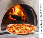 close up pizza in firewood oven ... | Shutterstock . vector #365567018