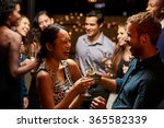 couples dancing and drinking at ... | Shutterstock . vector #365582339