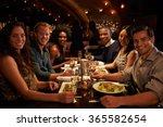 group of friends enjoying meal... | Shutterstock . vector #365582654