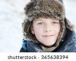 Little Boy In Winter A Fur Hat...