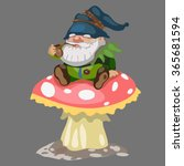 Gnome Sitting On A Mushroom An...