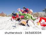 Happy Children Sledding At...