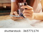 hands holding credit card and... | Shutterstock . vector #365771174