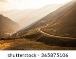 The Serpentine Road Through...