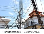 Small photo of Tangled power lines inane Asia city