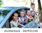 smiling children in the car | Shutterstock . vector #365931140