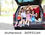 happy children sit on a car... | Shutterstock . vector #365931164