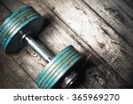 the old dumbbell on the wooden... | Shutterstock . vector #365969270