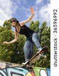 Urban life - Beautiful young women with skateboard - stock photo