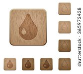 set of carved wooden waterdrop...