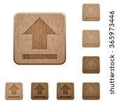 set of carved wooden upload...