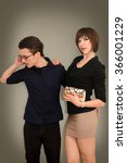 Stock photo young couple dressed elegantly standing in front of gray background 366001229