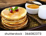 tasty pancakes with cranberry... | Shutterstock . vector #366082373