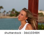 girl dreams against the blue sea | Shutterstock . vector #366103484