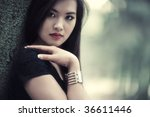 Young woman in forest portrait. Shallow dof. - stock photo
