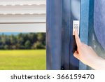 woman lifting electric shutters ... | Shutterstock . vector #366159470