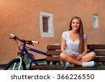 Teenage Girl And Bike In City