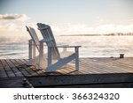 muskoka chairs on a dock over... | Shutterstock . vector #366324320