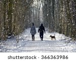Stock photo couple in the winter woods on a walk with the dog 366363986