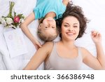 mother and daughter are lying... | Shutterstock . vector #366386948