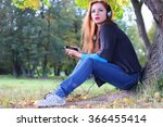 girl autumn leaves casual player | Shutterstock . vector #366455414