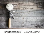 Stock photo scoop of vanilla ice cream on rustic wooden background 366462890