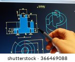 Small photo of engineer working on cad blue print
