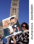 Small photo of OTTAWA, CANADA - MARCH 8, 2014: Inuit youth in sealskin garb hold a fashion show on Parliament Hill to protest against the European Union ban on imported seal products.