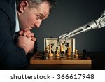 A Man Playing Chess With A...