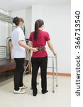 physical therapist helping... | Shutterstock . vector #366713540