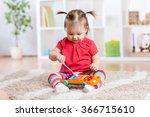 child little girl plays a... | Shutterstock . vector #366715610