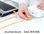 businessman connects his laptop ... | Shutterstock . vector #366785588