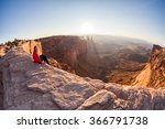 girl sitting at the mesa arch...   Shutterstock . vector #366791738