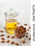 Small photo of almond oil organic healthy nut vegan vegetarian healthy white background wood teak rustic still life