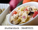 a fresh greek bow-tie pasta salad served cold - stock photo