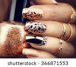 golden nail art manicure.... | Shutterstock . vector #366871553