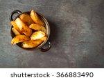 bowl of chunky potato wedges... | Shutterstock . vector #366883490