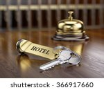 Stock photo hotel key and reception bell on reception desk 366917660