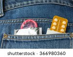 Small photo of Healthcare medicine, contraception and birth control. Closeup oral contraceptive pills, condom in denim pocket.