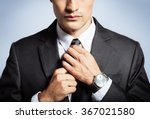 man fixing his tie.  | Shutterstock . vector #367021580