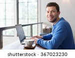 smiling man working on laptop... | Shutterstock . vector #367023230