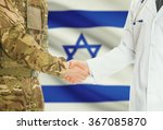 Soldier in uniform and doctor shaking hands with national flag on background - Israel
