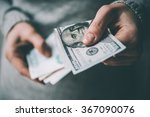 Hands Holding Russian Rouble...