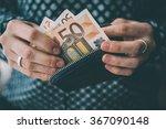 hands holding euro bills and... | Shutterstock . vector #367090148