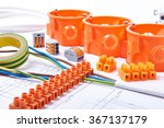 Electrical connectors with wires, junction box and different materials used for jobs in   electricity. Many tools lying on diagrams. Concept of electrical works. - stock photo