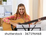 beautiful smiling woman holding ... | Shutterstock . vector #367196468