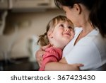 mother and daughter embracing...   Shutterstock . vector #367423430