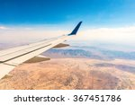Airplane Wing Over The Desert ...