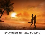Young Couple Silhouette On A...