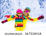 mother and little child skiing... | Shutterstock . vector #367528418